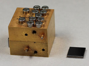 Picture: On the left, an amplifier using traditional waveguide technology. On the right, a component based on VTT's micromechanical waveguides.